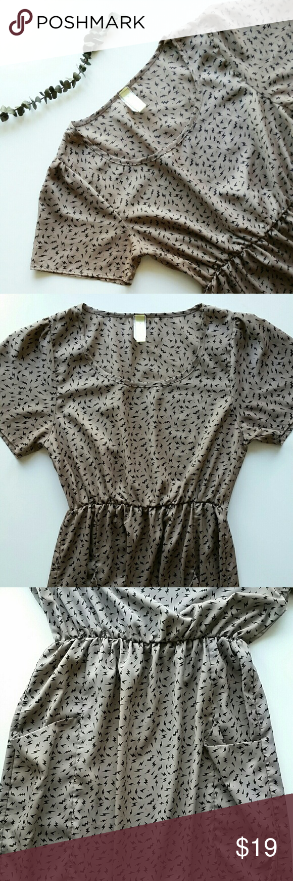 """Vintage Inspired Lightning Pocket Dress Lightning Pocket Dress *Mocha (Taupe) fabric and black lightning patterns  *Elastic waist band  *100% polyester? ?  *Size large  /Pit to pit : 16.5"""" flat  /Length : 34.5"""" *In great pre-loved condition  *No trade Please Bee Stiched  Dresses"""