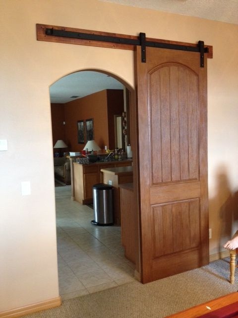 The Matching Arched Barn Door Compliments The Entry Opening And Is Paired Interior Barn Doors Arched Interior Doors Arched Barn Door