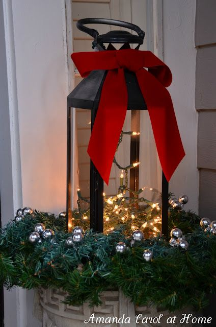 Front Porch Decor - planter urn with greenery & silver balls, lantern with mini lights and red bow