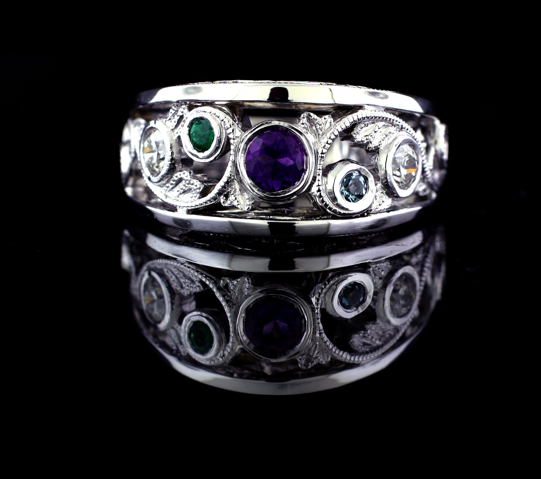 Hand made custom fabricated mothers ring with amethyst