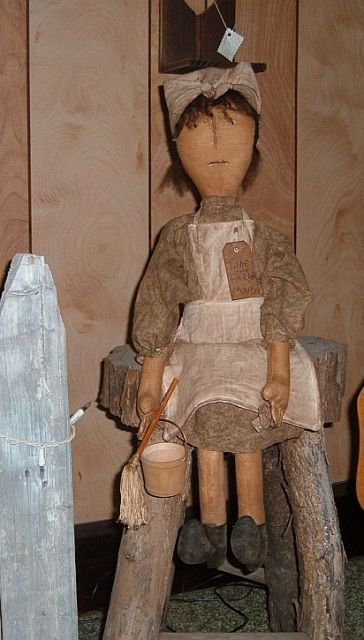 Tillie The Parlor Maid Doll is a very primitive doll. Tillie is made from muslin and has been stained with our own primitive stain. She has a stitched face, wool hair and sculpted fingers. Tillie wears an aged dress and apron.