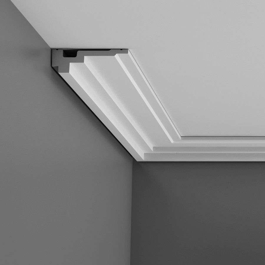 Crown molding for vaulted ceilings - A Small Flat Cornice Extending Accross The Ceiling And Providing A Intriguing Floating Effect Thanks To Its Recessed Shadow Line At The Back