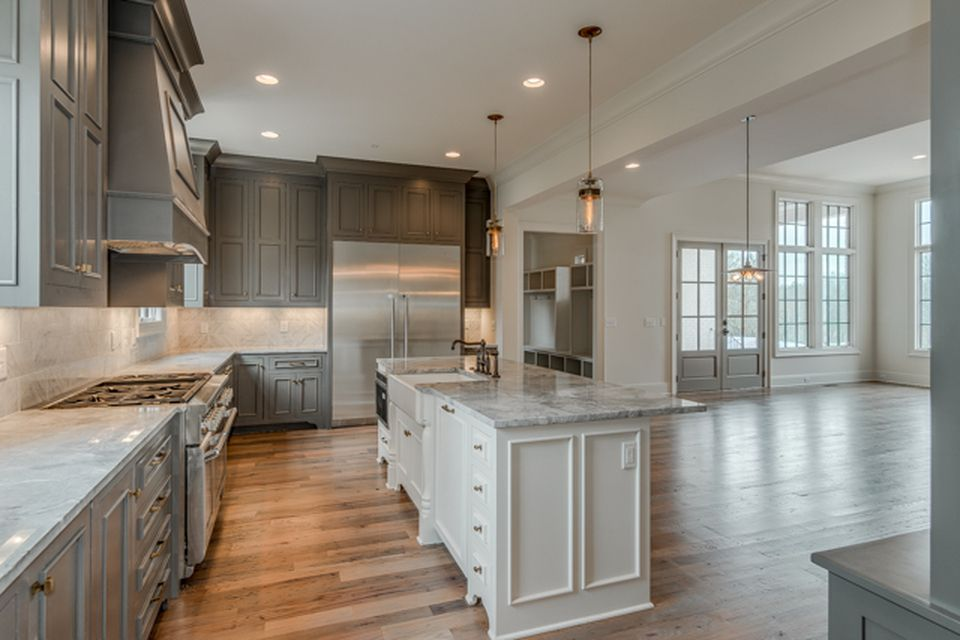 Portfolio Vintage South Development Darker Gray Cabinets With White Island And Countertops Open Kitchen Layouts Kitchen Layout House
