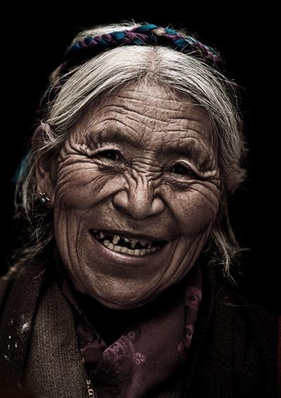 """DIASPORA SMILE    """"Diaspora Smile"""" is a part of an ongoing photographic project that captures the joy of elderly Tibetan refugees who lived in exile for more than fifty years. I regularly took their portraits on the night after they have received private blessing from His Holiness Dalai Lama."""