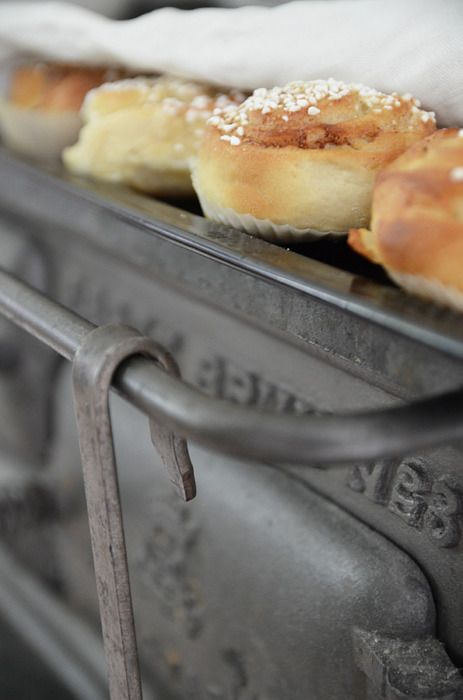 Food Warmer Under Oven ~ Rolls warming under towel on cast iron stove food
