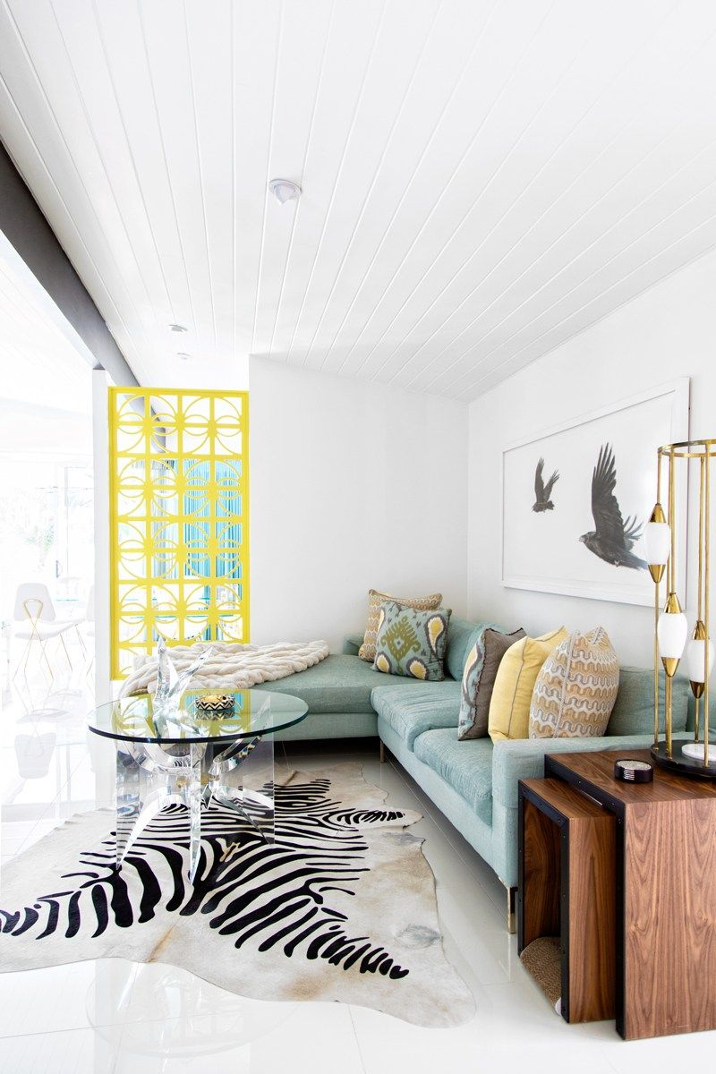 A palm springs home tour the english room mint sofa and yellow
