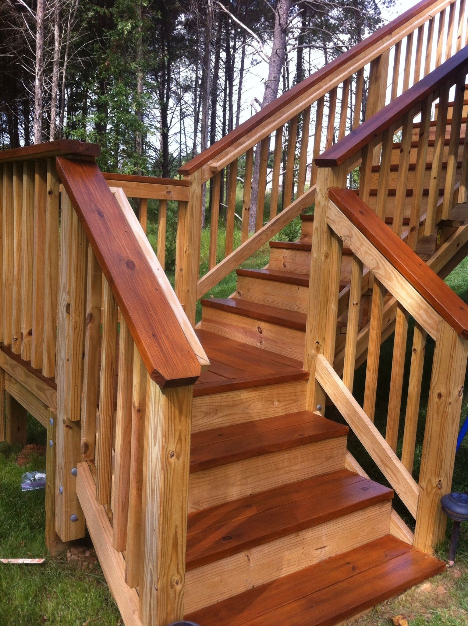 Railing and baluster ideas deckorators metal balusters wood two toned stained deck baanklon Image collections