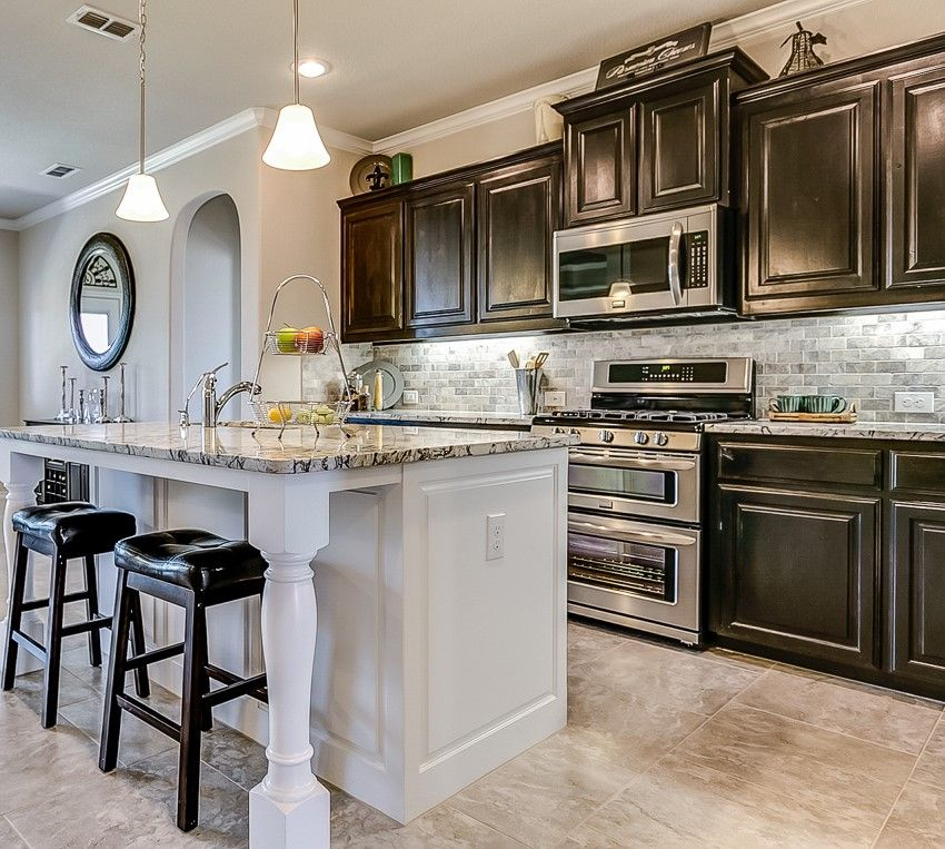 Gorgeous Black Cabinets And White Island In Denton Texas Findyourhome Drhorton Home Black Cabinets New Homes