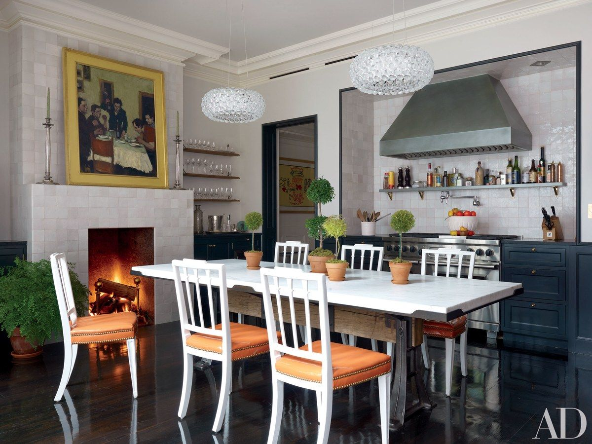 George iiiustyle dining chairs surround a table by made in the