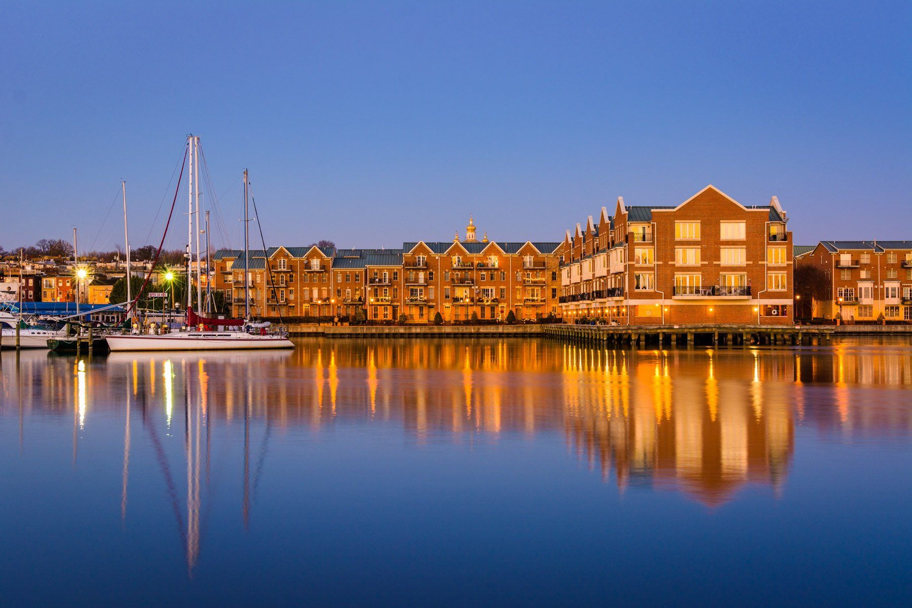 Buildings on the canton waterfront at twilight in