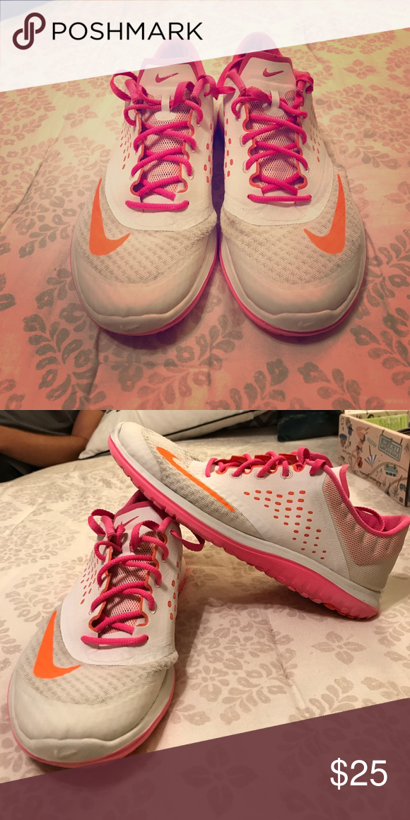 Nike shoes Pink and white nike shoes with orange check mark. Nike Shoes  Sneakers