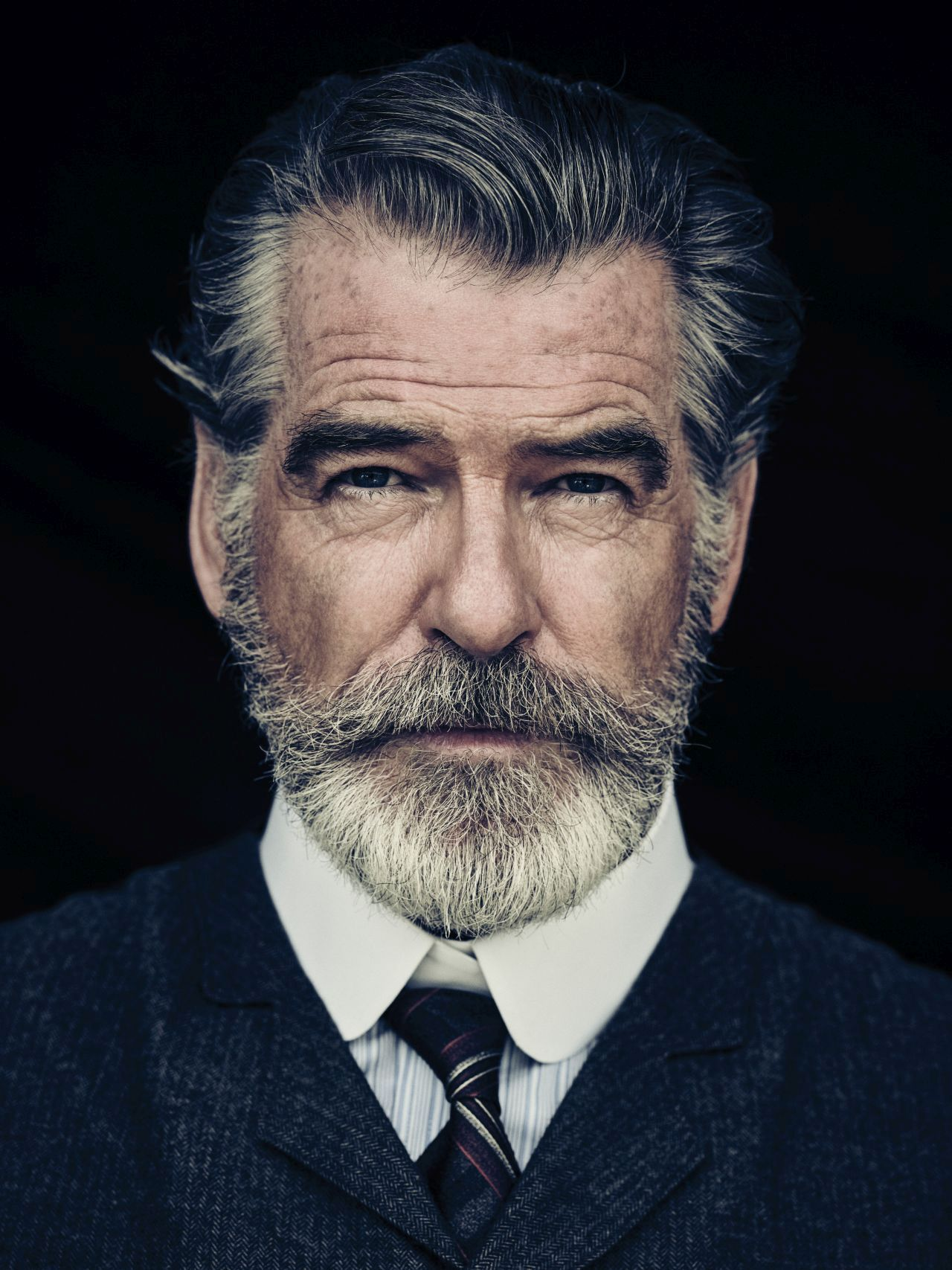 pierce brosnan jokes his wife is very fond of the beard he grew
