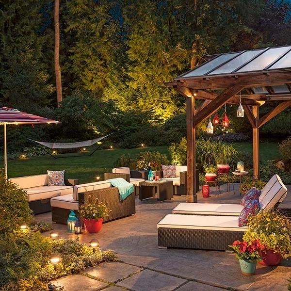 backyard escape ideas lounge furniture pergola outdoor lighting