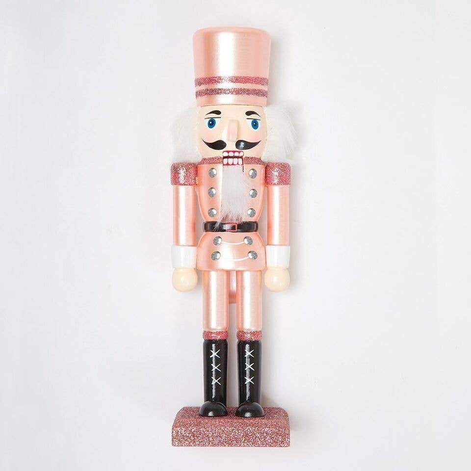 Your Christmas and holiday decor just got a lot cuter with our pink metallic rose gold nutcrackers.