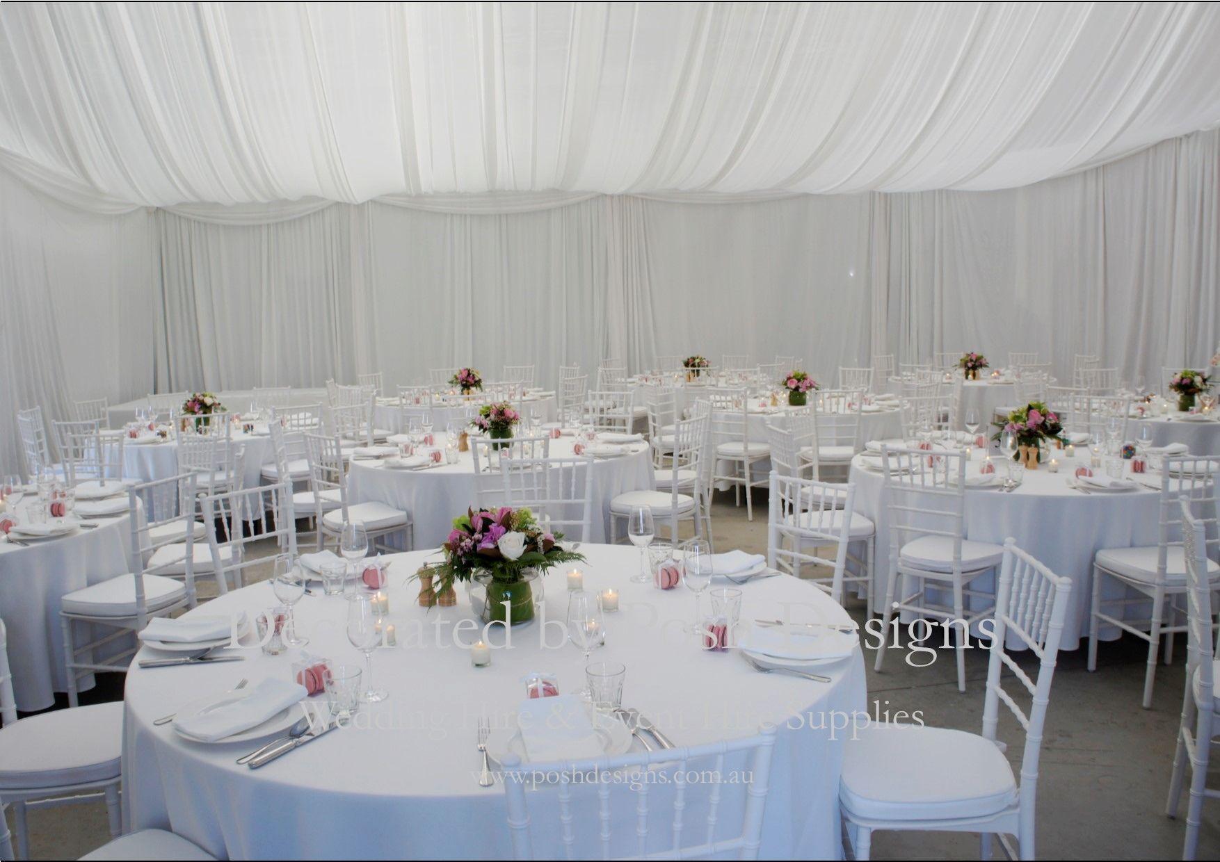 White tiffany chairs, white table cloths, flower white ...