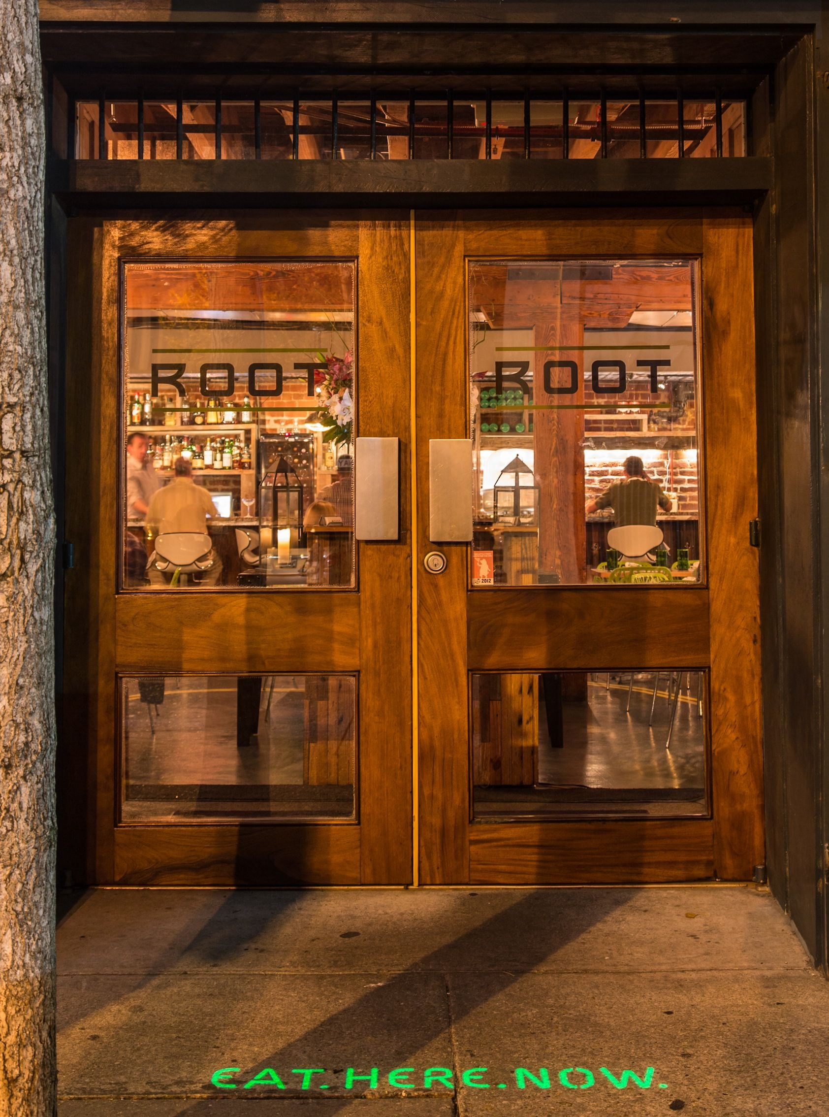 Wood and glass entrance doors with transom at root