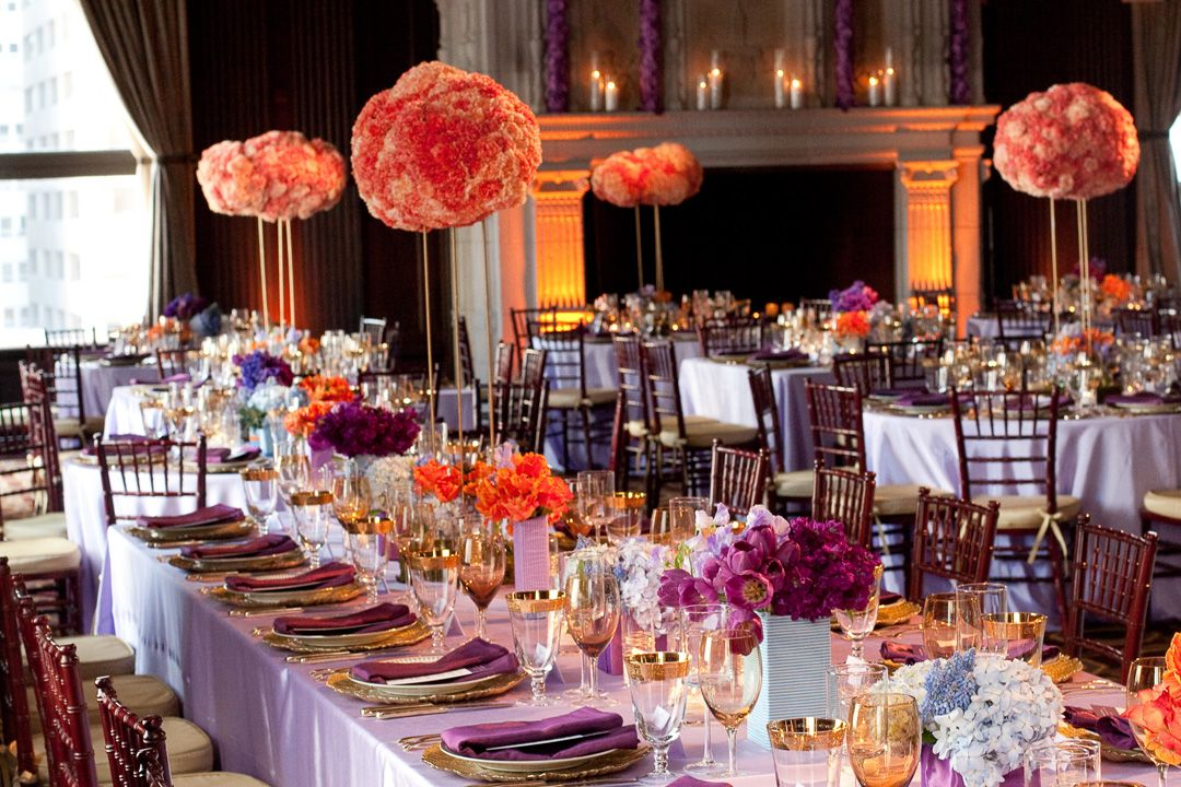 Travel Theme Purple Tables With Tall Orange Flower Centerpieces