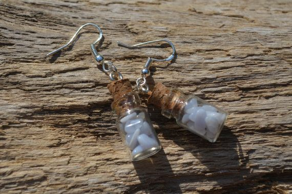 Genuine blue lace agate stone chips in glass vials make a lovely earring set. The earrings are made from a pair of glass vials filled with blue