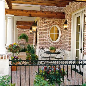 Style Guide: 61 Breezy Porches and Patios | Colorful Potted Porch | SouthernLiving.com