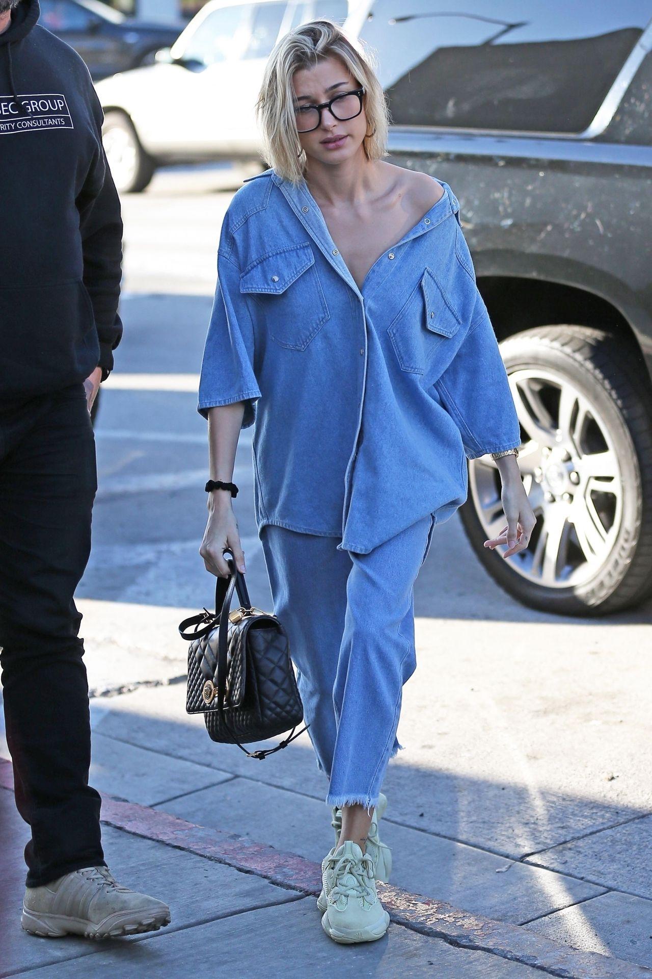74e21b5996 Hailey Baldwin is dressed in a Denim Nanushka Shirt and Jeans ...