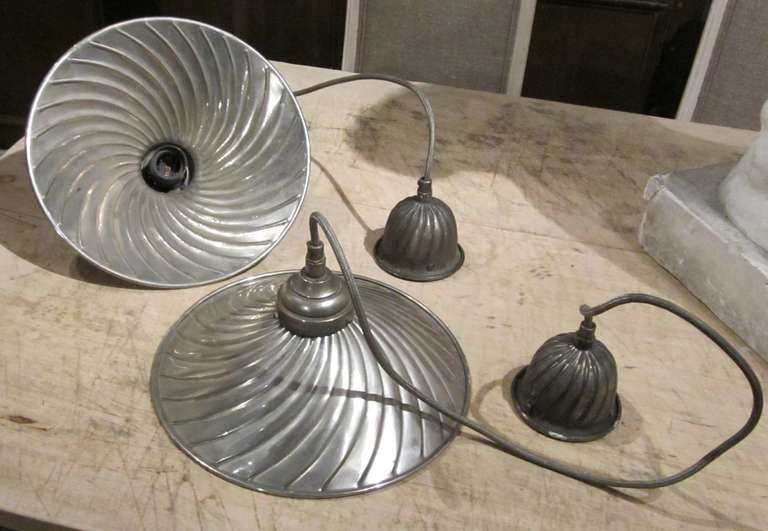 1940's French ribbed nickel plated pendant lights. www.balsamoantiques.com