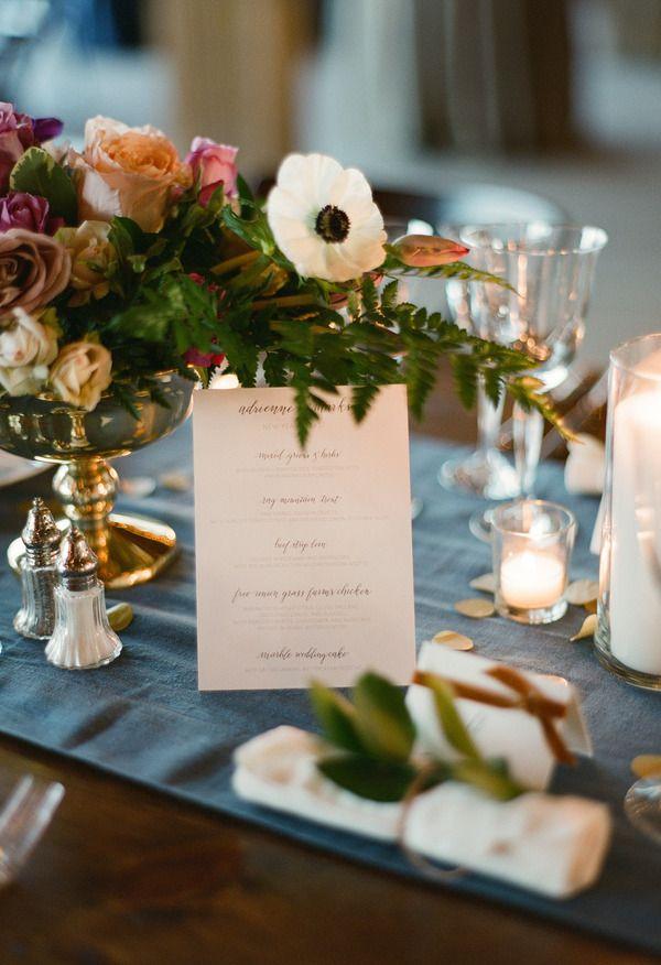 In-season anemones, white pillar candles, golden details ...