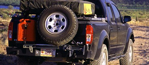 Nissan Frontier / Navara D40 Shown With Off Road Rear Bumper (Multi  Carrier) By KMA With Shackle Mounts, Swing Out Tire Carrier, Xtreme Hi Lift  Jack, .