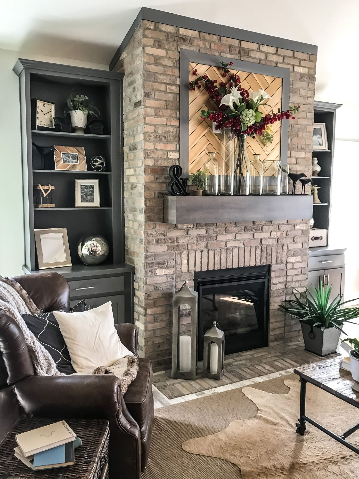 A Warm And Cozy Living Room Featuring An Updated Traditional Brick