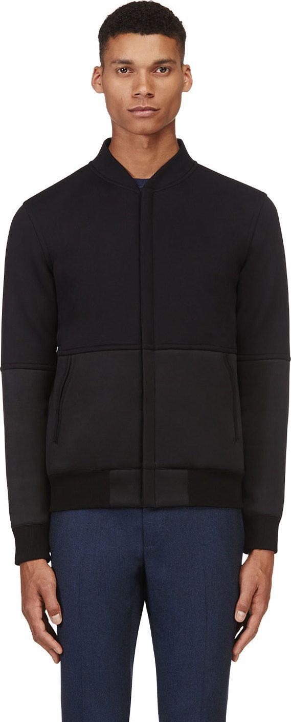 Calvin Klein Collection - Black Neoprene Panel Bomber Jacket - Stand collar. Concealed zip closure at front. Tonal neoprene panelling at forearms and lower torso. Welt pockets at front. Ribbed sleeve cuffs and hem in jet black