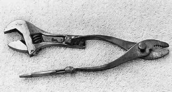 Multi-Tool by  -- Homemade multi-tool comprised of a crescent wrench and flat-bladed screwdriver welded to a pair of slip-joint pliers. http://www.homemadetools.net/homemade-multi-tool-2