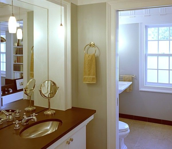 Alexandria, VA  Classic period styled moldings frame out this handsome, award-winning bath restoration. Superior craftsmanship and fine attention to detail was necessary to create a space reminiscent of the homes 19th century past.