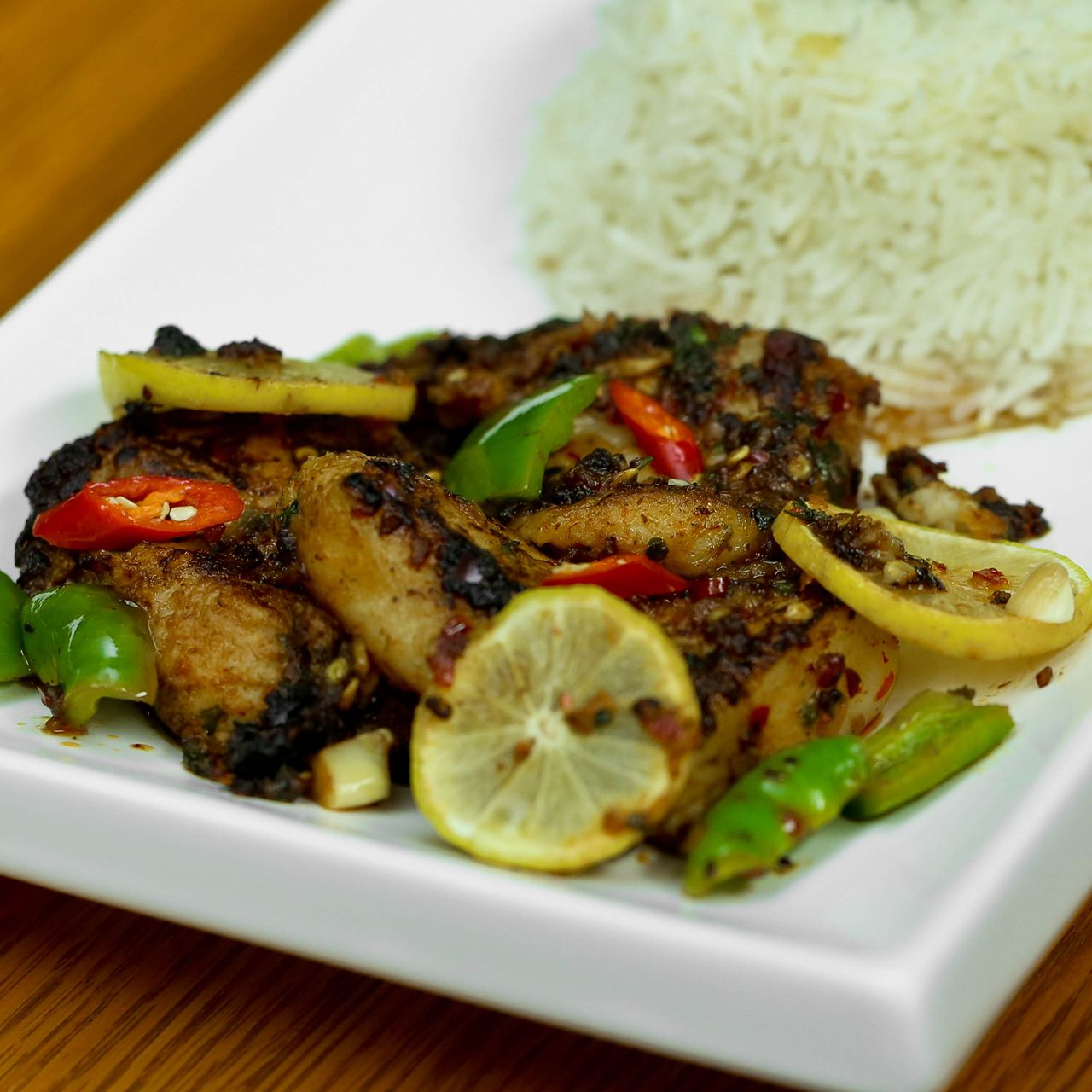 Pangasius fish seared with aromatic spices and packed with