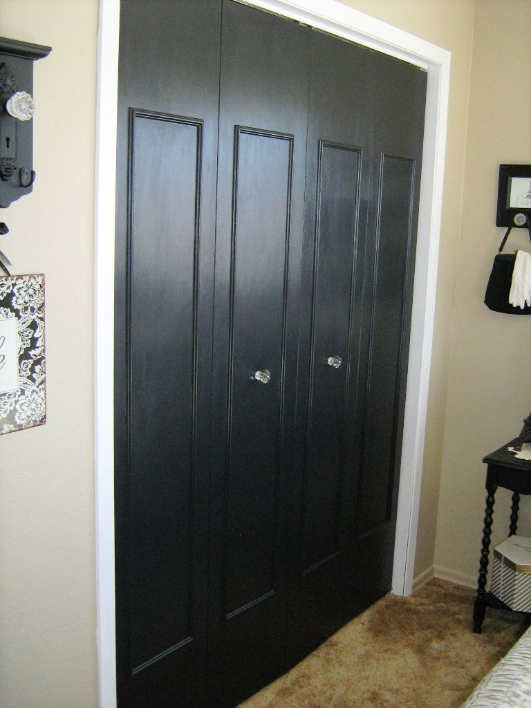 updated bifold closet doors add trim paint and change the knobs