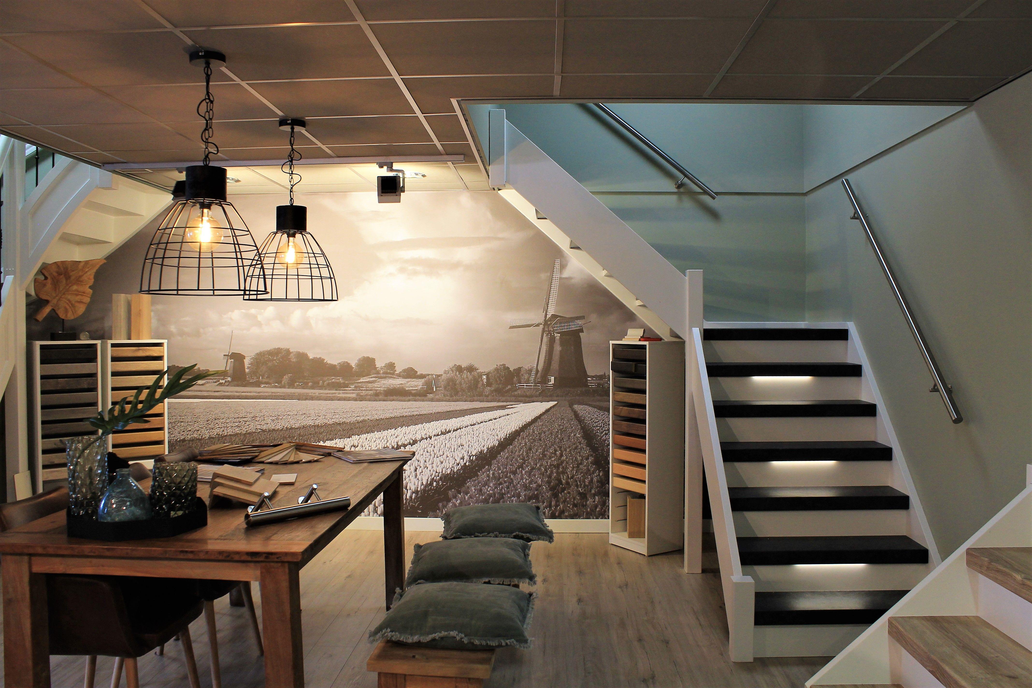 Prachtige muurfoto in de traprenovatie showroom stairz team