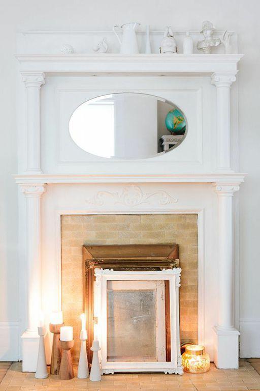 White mantelpiece + candles // Kate Davison's San Francisco Home Tour #theeverygirl