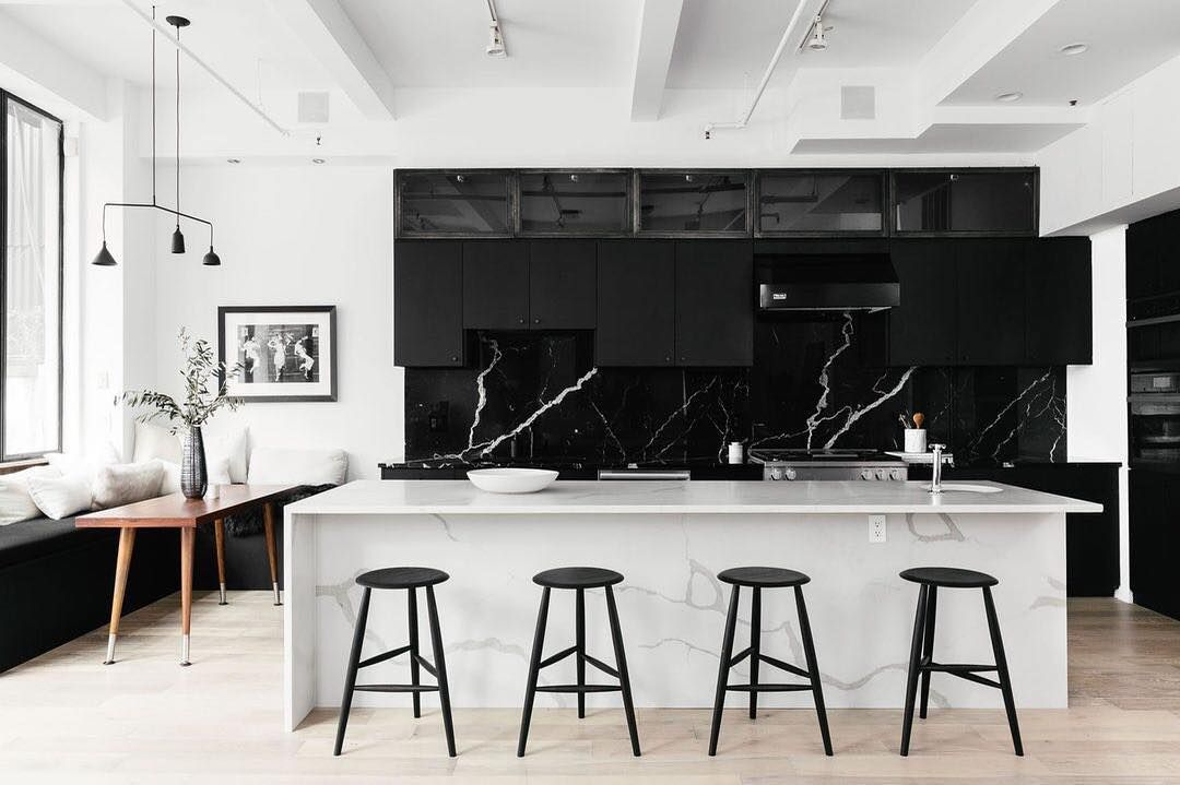 A clean, contrast-heavy kitchen designed with black and