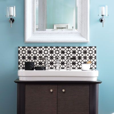 Tile the wall above your bath vanity with graphic ceramic squares. Adhere  the new backsplash