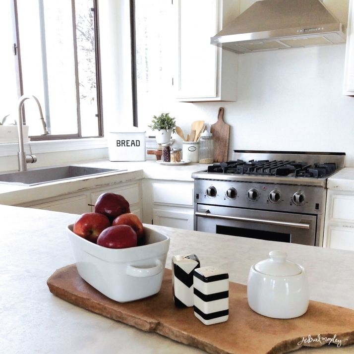 Before & After Aedriel Moxley House Tour: Kitchen - love the natural, rustic cutting board