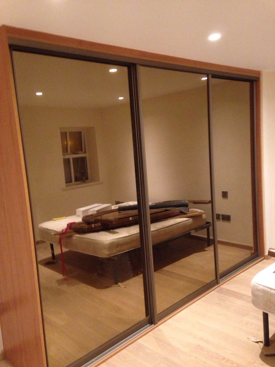 Tinted Mirror Doors With Cherry Interior Wardrobe Ideas