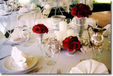 White napkins keep things feeling bright and wedding like add red simple red centerpiece in silver vases junglespirit Gallery