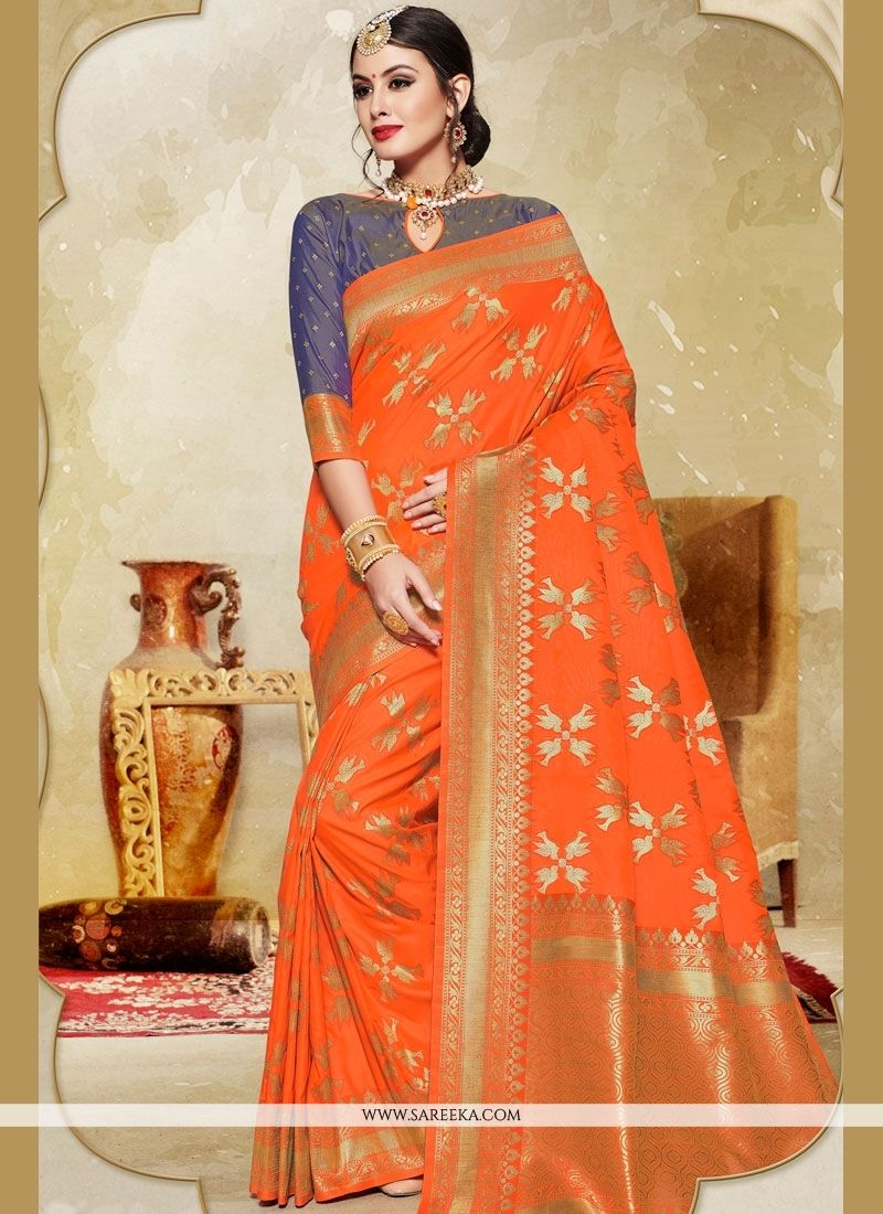 c8f34b03766f2 Attractive orange color printed silk saree. Comes with matching blouse.  (Slight variation in color
