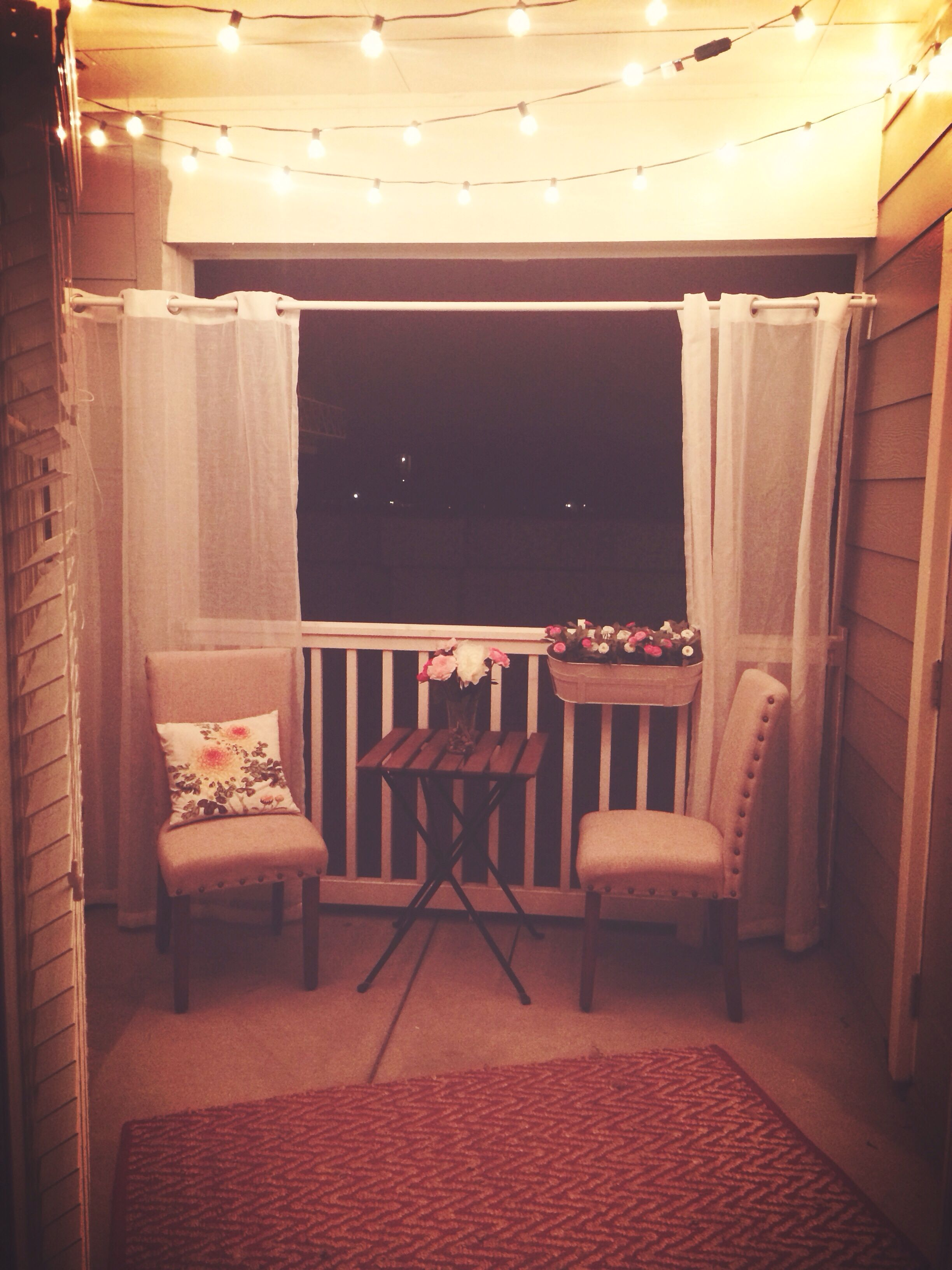 Curtain For Balcony: Small Apartment Patio With Lights Strung At Night