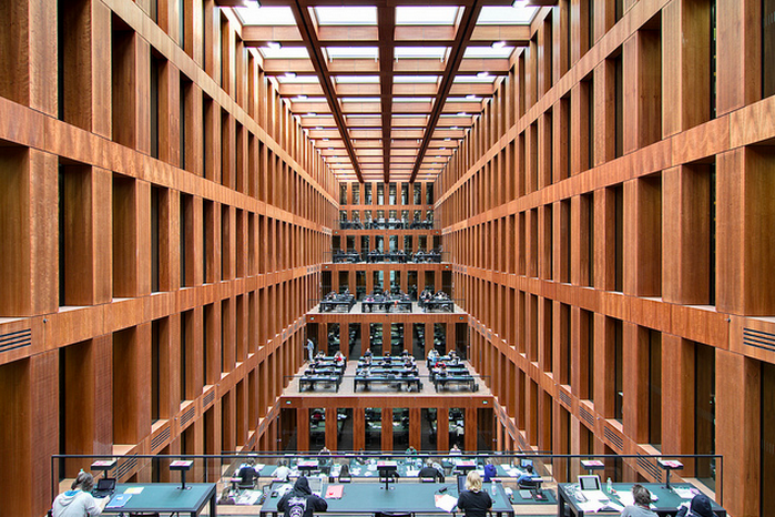 "The Reading Hall of the Library of Berlin's Humboldt University, designed by Max Dudler Architects, 2010. The central reading hall is the building's core. With its strict symmetry and impressive galleries it creates a common culture space in the sense of the ""Old Library""."
