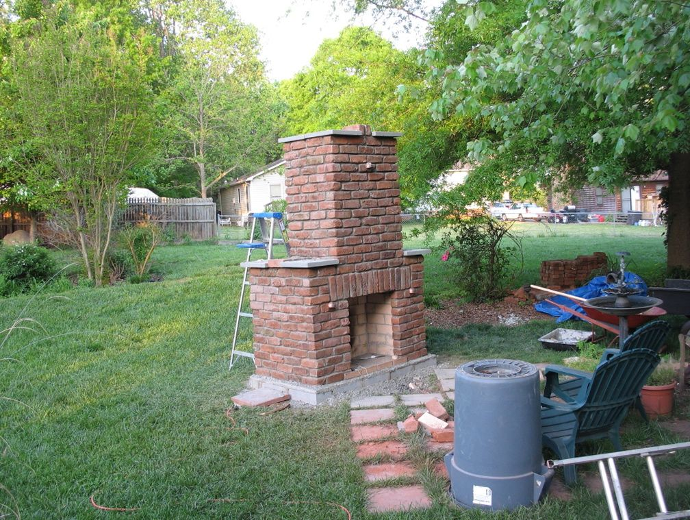 Small Outdoor Brick Fireplace Home Design Ideas