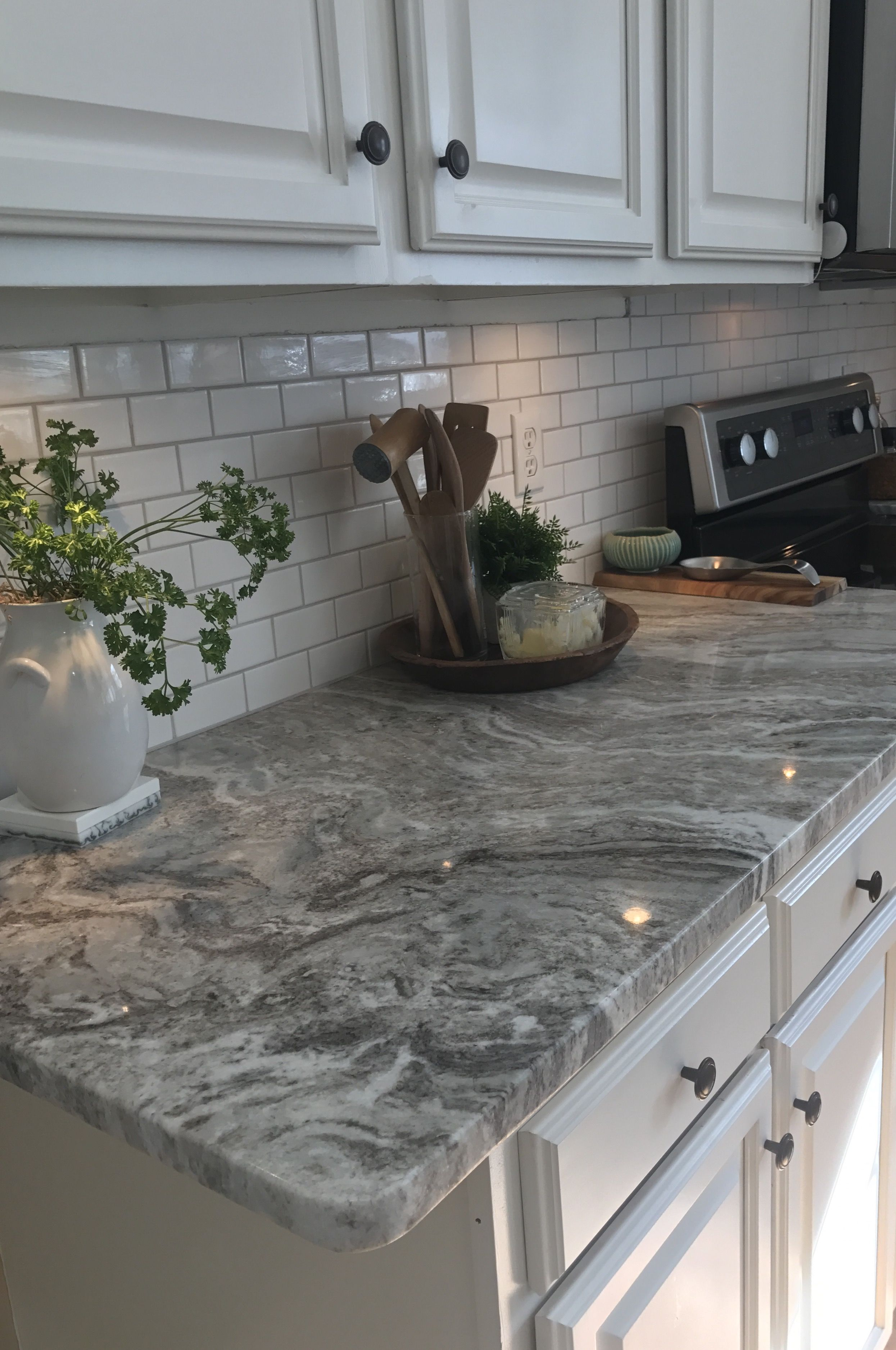 Fantasy Brown granite with small white subway tiles and ...