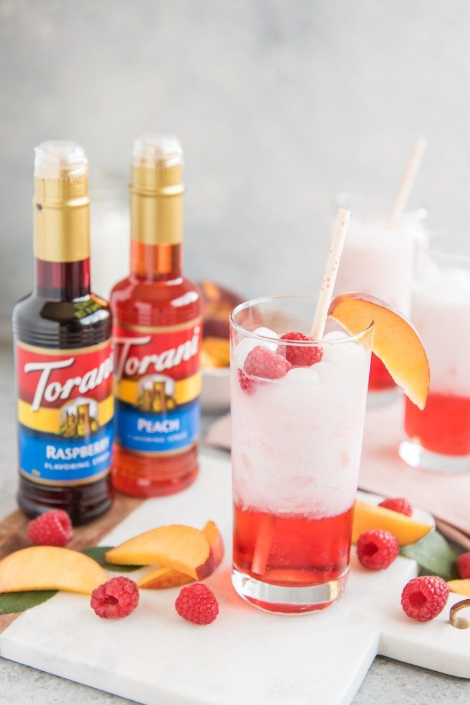 These Easy And Refreshing Raspberry Peach Italian Cream Sodas Made With Torani Syrups Are The Perfect Non A Italian Cream Soda Torani Syrup Recipes Soda Recipe