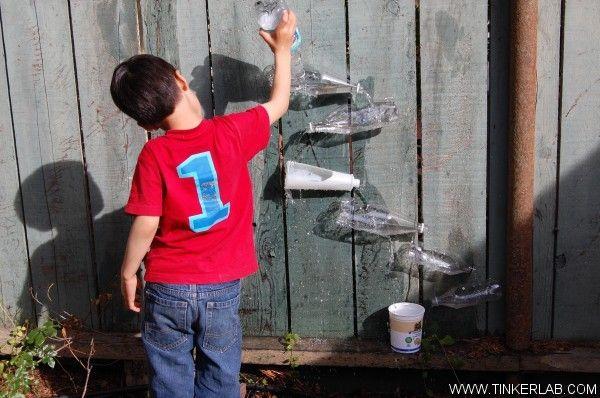 DIY Water Wall ~ I'd add a kid garden underneath and make that last bottle a rain spout (poke lots of holes in it)