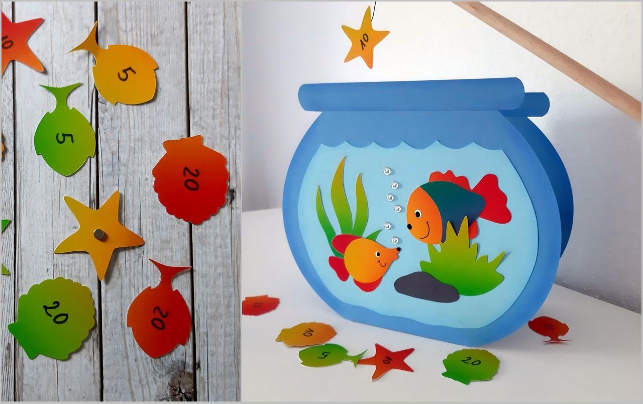 Erst basteln, dann spielen! Wer von Euch angelt die buntesten Fische, Muscheln und Seesterne ohne dabei ins Aquarium zu schauen?