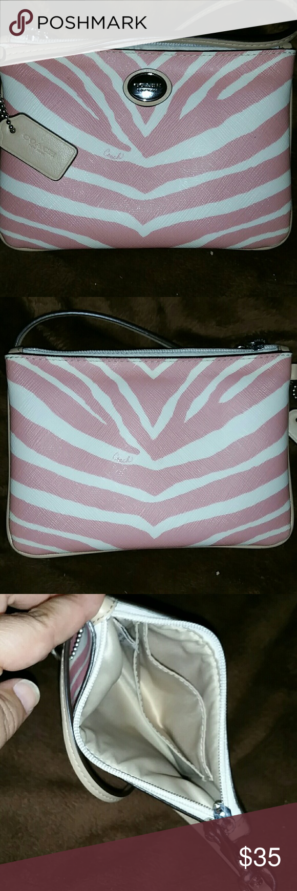 Authentic coach wristlet Used 1 time, this pink and white zebra print wristlet would be a perfect accessory to your summer ensemble. It is absolutely flawless with zero marks, scuffs, or stains. Hurry up and get this today before someone else snatches this beautiful wristlet :) Coach Bags Clutches & Wristlets