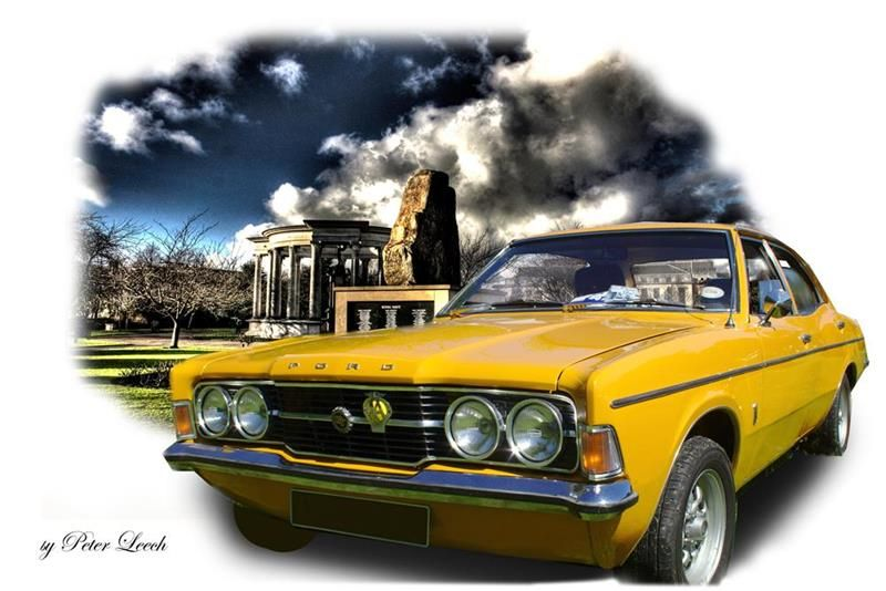 This Bright Yellow Ford Cortina Mk3 Gt Is Set In The War Memorial